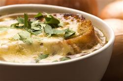 Garnish your slow-cooked French onion soup with fresh greens for an extra touch.