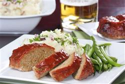 Top your meatloaf with your favorite barbecue sauce and serve with potatoes and veggies for a complete meal.