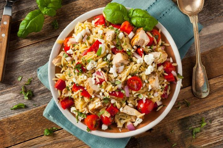 It's easy to add diced chicken to your enchilada orzo as well.