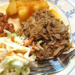 Eastern NC Chopped Turkey Barbecue served with baked beans, coleslaw, and spicy boiled potatoes.